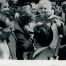 Marliyn Monroe surrounded by people.  - 8x10 photo