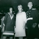 Sylvie Vartan standing between two women. - 8x10 photo