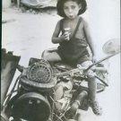 Sicilian Youngster enjoys a candy bar, 1943. - 8x10 photo