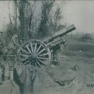 Soldiers using cannon during wartime. - 8x10 photo