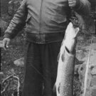 Jussi Björling holding a fish. - 8x10 photo