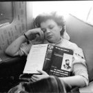 Judy Garland sleeping, with book on her chest. - 8x10 photo