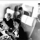 Judy Garland holding with plane food. - 8x10 photo