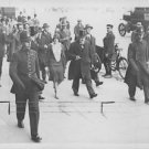 Winston Churchill walking with his companions. - 8x10 photo