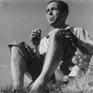 Humphrey Bogart smoking. - 8x10 photo