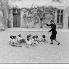 Josephine Baker dancing in front of her children. - 8x10 photo