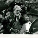 Ernest Hemingway surrounded by people.  - 8x10 photo