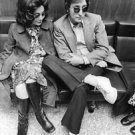 John Lennon sitting with Yoko Ono. - 8x10 photo