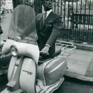 Sammy Davis Jr. posing on scooter.  - 8x10 photo