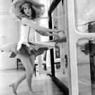 Catherine Deneuve in hat practicing dance. - 8x10 photo