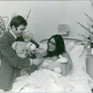 Man brought toys for his newborn baby in hospital.  - 8x10 photo