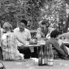Sherpa Tenzing having a meal wit friends. - 8x10 photo