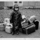 World War II. Child moved to safety. - 8x10 photo