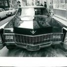 Luxurious car parked on roadside.  - 8x10 photo
