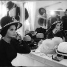 Sophia Loren, in her green room, with hats. - 8x10 photo