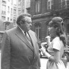 Orson Welles with Leslie Caron. - 8x10 photo