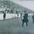 People in sport stadium, spectators looking at Major Genral Viktor Balck and com