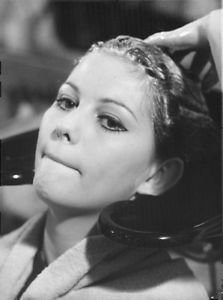 Claudia Cardinale getting he hair washed. - 8x10 photo
