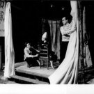 Yves Saint Laurent crouching on stage - 8x10 photo
