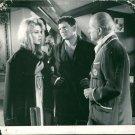 Brigitte Bardot in discussion with men.  - 8x10 photo