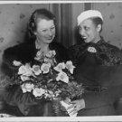 Josephine Baker with flowers.  - 8x10 photo