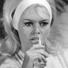 Brigitte Bardot drinking. - 8x10 photo