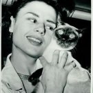 Harriet Andersson with Titus, her cat. - 8x10 photo