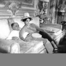 Sophia Loren and Carlo Ponti sitting in sofa. - 8x10 photo
