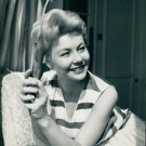 Mitzi Gaynor smiling. - 8x10 photo