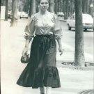 Maria Callas, while walking outside. - 8x10 photo