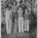 Paulette Goddard with sons of Charlie Chaplin and H G Wells. - 8x10 photo