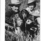 Clark Gable with a woman and dog.  - 8x10 photo