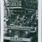 Soldiers moving through jeep. - 8x10 photo