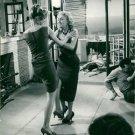 Brigitte Bardot fighting with a woman.  - 8x10 photo