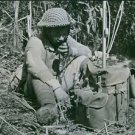 Chinese radio operator on the front lines in Northern Burma. - 8x10 photo