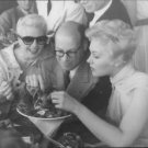Ginger Rogers and Kim Novak eating shrimps. - 8x10 photo