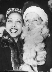 Josephine Baker smiling with Santa Clause. - 8x10 photo