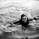 Geraldine Chaplin swimming. - 8x10 photo