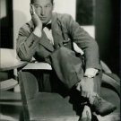Maurice Chevalier sitting. - 8x10 photo