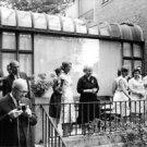Mamie Eisenhower in a garden party. - 8x10 photo