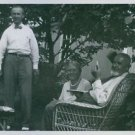 Robert Ulich standing while Elsa Brandstrom sits next to a man smoking a cigaret