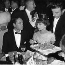 Audrey Hepburn and Mel Ferrer in a party. - 8x10 photo