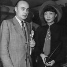 Charles Boyer and Anna May Wong at reception in Hollywood. - 8x10 photo