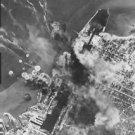 World War II. U.S. Bombers blast German U-boat base - 8x10 photo