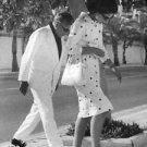 Maria Callas walking with Ari Onassis. - 8x10 photo