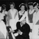 Josephine Baker playing piano and smiling.  - 8x10 photo