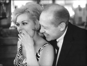 Kim Novak with man. - 8x10 photo