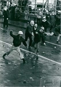 People throwing stones during demonstration in Japan - 8x10 photo