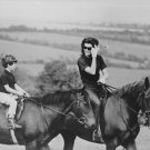Jacqueline Kennedy Onassis riding with her son. - 8x10 photo