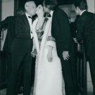Omar Sharif and a man kissing Barbra Streisand.  - 8x10 photo